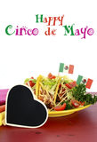 Cinco de Mayo bright colorful party food. Happy Cinco de Mayo bright colorful party food with platter of tacos on red wood table Stock Photos
