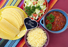 Cinco de Mayo bright colorful party. Happy Cinco de Mayo bright colorful party with ingredients for assembling tacos on festive red wood table