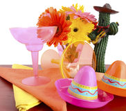 Cinco de Mayo bright colorful party table place setting. Happy Cinco de Mayo bright colorful party table place setting with bright gerbera daisy flowers on