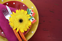 Cinco de Mayo bright colorful party table place setting. Happy Cinco de Mayo bright colorful party table place setting with bright gerbera daisy flowers on Royalty Free Stock Images