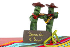 Cinco de Mayo concept with fun Mariachi Band Cactus players. Happy Cinco de Mayo concept with fun Mariachi Band Cactus players and greeting card on red wood royalty free stock image