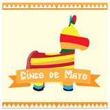 Cinco de mayo. Donkey toy and a ribbon with text on a white background