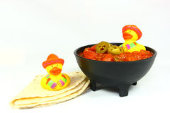Cinco De Mayo Ducks. Two yellow rubber ducks dressed in sombreros and serapes celebrate Cinco De Mayo with a big bowl of salsa and a warm tortilla stock images