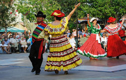 Cinco de Mayo festival dancers in costume. Cinco De Mayo dancers performing in the town square of The Villages in Florida USA. Dancing in costume on the town