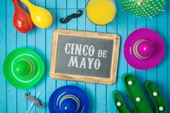 Cinco de Mayo holiday background with chalkboard, Mexican cactus and party sombrero hat on wooden board. Top view from above royalty free stock photos