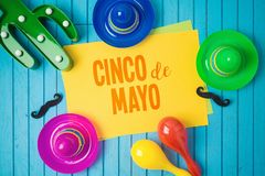 Cinco de Mayo holiday background with Mexican cactus and party sombrero hat on wooden board. Top view from above stock photography