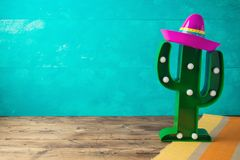 Cinco de Mayo holiday background with Mexican cactus and  party sombrero hat. On wooden table royalty free stock images