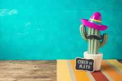 Cinco de Mayo holiday background with Mexican cactus and  party sombrero hat. On wooden table stock photography