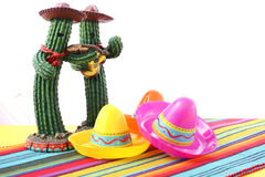 Cinco de Mayo Mariachi Band. Cactus with sombero hats on festive table with white background, and copy space Stock Image