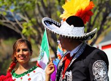 Cinco De Mayo Parade. Woman holding the Mexican flag during the Cinco De Mayo parade in Saint Paul, Minnesota Royalty Free Stock Image