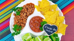 Cinco de Mayo party food platter with corn chips, chilli beans and salsa. Royalty Free Stock Photo