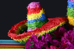 Cinco de Mayo Party Table. Colorful Happy Cinco de Mayo party table with rainbow sombrero pinata against a black background Royalty Free Stock Photo