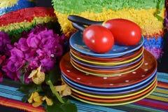Cinco de Mayo Party Table. Colorful Happy Cinco de Mayo party table with rainbow straw donkey and sombrero pinata against a black background Royalty Free Stock Photo