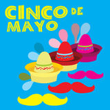 Cinco de Mayo yellow lettering on a blue background. Cinco de Mayo meaning fifth of May in Spanish on a blue background Stock Images