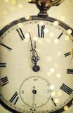Cinco a doze Face do relógio e decoração das luzes do partido Imagem de Stock