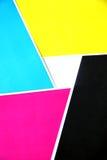 Cinco espolones de las hojas de los colores en cuadrados. Imagenes de archivo
