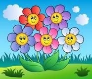 Cinco flores de la historieta en prado Foto de archivo libre de regalías