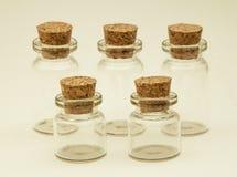 Cinco frascos de vidro com cortiça Imagem de Stock Royalty Free