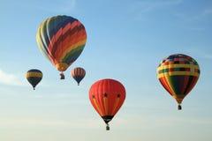 Globos coloridos en cielo Imagen de archivo libre de regalías