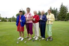 Cinco golfistas Imagen de archivo libre de regalías