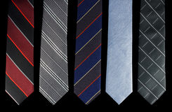 Cinco gravatas são cores diferentes Fotografia de Stock Royalty Free