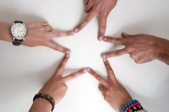 Cinco manos de los adolescentes forman una estrella Fotos de archivo libres de regalías
