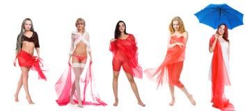Cinco muchachas en rojo Imagen de archivo libre de regalías