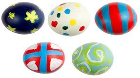 Cinco ovos de Easter isolados Imagens de Stock