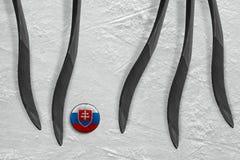 Cinco palillos de hockey y duende malicioso eslovaco Imágenes de archivo libres de regalías