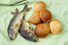 Cinco panes, y los dos pescados Imagen de archivo libre de regalías
