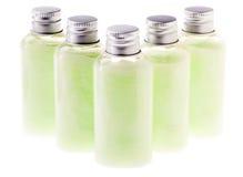 Botellas verdes aisladas de la loción Imagen de archivo libre de regalías