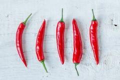 Cinco pimentas Imagens de Stock Royalty Free