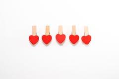 Cinco pinos de madeira com o coração dado forma Imagens de Stock Royalty Free