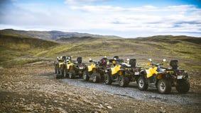 Cinco quadriláteros amarelos nos interiores de Islândia ATV Imagens de Stock Royalty Free