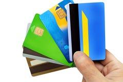 Cinco tarjetas de crédito en dedos Fotos de archivo libres de regalías