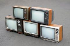Cinco televisiones antiguas Imagen de archivo libre de regalías