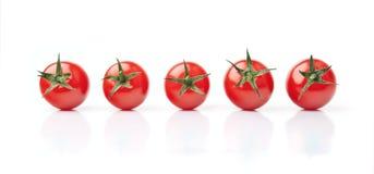 Cinco tomates de cereja Fotografia de Stock
