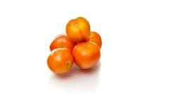 Cinco tomates frescos Foto de Stock