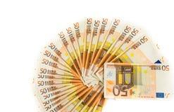 Cincuenta cuentas euro en el fondo blanco banknotes fotografía de archivo