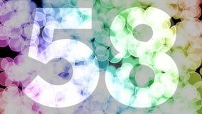 Cincuenta y siete a cincuenta y ocho años de cumpleaños se descoloran la animación de in/out con el fondo de mudanza del bokeh de ilustración del vector