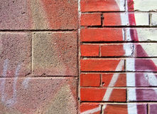Cinder Block and Brick Wall with Graffiti Royalty Free Stock Image