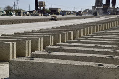 Cinder blocks lie on the ground and dried. on cinder block production plant. Stock Images