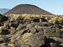 Cinder cone near Fossil Falls in California. Cinder cone in the Fossil Falls area, Inyo County, California Royalty Free Stock Photo