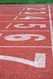 Cinder path in the stadium. Place to start and finish the race. Perspective. Vertical image royalty free stock photography