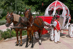Cinderella carriage. A carriage drawn by a pair of horses, made by motifs from the stories of Cinderella exposed to the occasion on September 7, the day the Royalty Free Stock Images