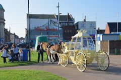 Cinderella carriage ride by Great Yarmouth seafront. Great Yarmouth  Norfolk  , United Kingdom - October 25, 2016:  Cinderella carriage ride by Great Yarmouth Stock Image