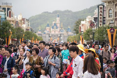 Cinderella Castle at Disneyland, Hong Kong. Visitors in front of Cinderella Castle at Disneyland, Hong Kong Stock Photo