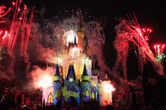 Cinderella Castle illuminated at night by fireworks, Magic Kingdom, Disney Stock Photo