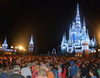 Cinderella Castle illuminated at night, Magic Kingdom, Disney. Cinderella Castle illuminated at night at Christmas season, Crowd of people in Magic Kingdom Royalty Free Stock Photos