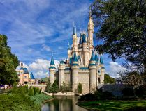 Cinderella Castle at Walt Disney World theme parks. Full view of beautiful Cinderella Castle with river and tree at Walt Disney World theme park Magic Kingdom Stock Photos